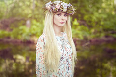 Beautiful blonde woman with flower wreath on her head Stock Image