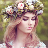 Beautiful blonde woman with flower wreath on her head Royalty Free Stock Photography