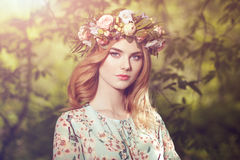 Beautiful blonde woman with flower wreath on her head Stock Images