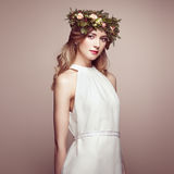 Beautiful blonde woman with flower wreath on her head Royalty Free Stock Image