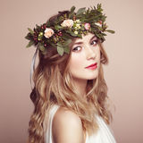 Beautiful blonde woman with flower wreath on her head Royalty Free Stock Photos