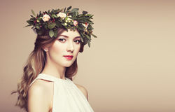 Beautiful blonde woman with flower wreath on her head Stock Photo