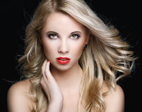 Beautiful blonde woman with flying hair Royalty Free Stock Photography