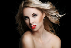 Beautiful blonde woman with flying hair Royalty Free Stock Photo