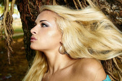 Beautiful blonde woman in the forest Stock Photo