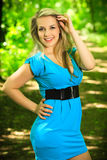 Beautiful blonde woman on a forest road Royalty Free Stock Image