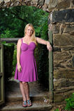 Beautiful Blonde woman in fuchsia dress Stock Photo
