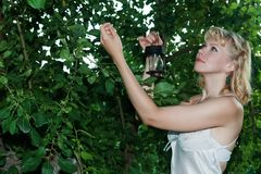 Beautiful blonde woman in garden Stock Photography