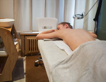 Beautiful blonde woman gets spa treatment in salon Royalty Free Stock Photography