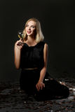 Beautiful blonde woman with glass of white wine on black background Royalty Free Stock Photography