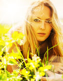 Beautiful blonde woman on grass Royalty Free Stock Photos