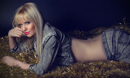 Beautiful blonde woman in grey jeans Royalty Free Stock Photos
