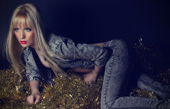 Beautiful blonde woman in grey jeans Royalty Free Stock Image