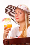 Beautiful blonde woman in a hat drinking juice Royalty Free Stock Photo