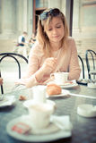Beautiful blonde woman having breakfast at the bar Royalty Free Stock Images