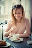 Beautiful blonde woman having breakfast at the bar Stock Image