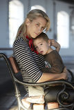 Beautiful blonde woman and her little son together Royalty Free Stock Image