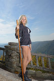 Beautiful blonde woman hiker stands at overlook Royalty Free Stock Images