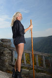 Beautiful blonde woman hiker stands at overlook Stock Image