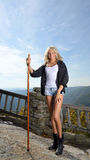 Beautiful blonde woman hiker stands at overlook Royalty Free Stock Photo