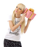 Beautiful blonde woman holding gift Royalty Free Stock Photos