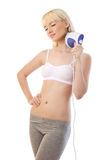 Beautiful blonde woman holding massager Stock Images