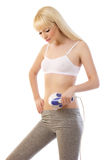 Beautiful blonde woman holding massager Royalty Free Stock Photos