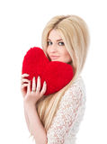 Beautiful blonde woman holding red heart Stock Image