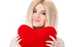 Beautiful blonde woman holding red heart Stock Photography