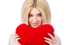 Beautiful blonde woman holding red heart Stock Photo