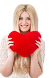 Beautiful blonde woman holding red heart Royalty Free Stock Images