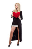 Beautiful blonde woman holding red heart Royalty Free Stock Photo