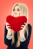 Beautiful blonde woman holding red heart Royalty Free Stock Image