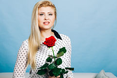 Beautiful blonde woman holding red rose Royalty Free Stock Photo
