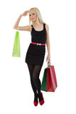 Beautiful blonde woman holding shopping bags Stock Photo