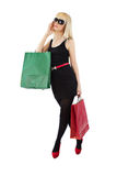Beautiful blonde woman holding shopping bags Stock Photos