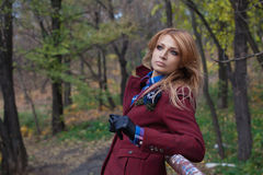 Beautiful blonde woman in jacket and leather gloves in autumn fo Royalty Free Stock Photo
