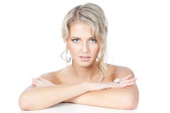 Beautiful blonde woman with jewelry over white Royalty Free Stock Images