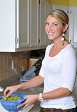 Beautiful blonde woman in kitchen Stock Photo