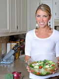 Beautiful blonde woman in kitchen Stock Image