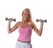 Beautiful blonde woman lifting weights. Beautiful blonde woman in fitness clothes exercising with weights isolated on white Royalty Free Stock Photos