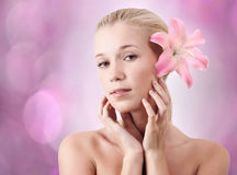 Beautiful blonde woman with lily flower Stock Image