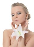 The beautiful blonde woman with lily flower Stock Photography