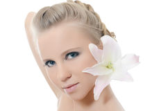 The beautiful blonde woman with lily flower Royalty Free Stock Image