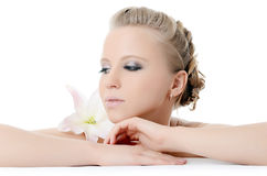 Beautiful  blonde woman with lily flower Stock Photography