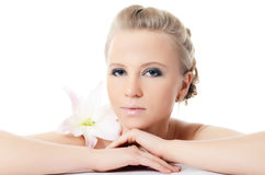 Beautiful  blonde woman with lily flower Royalty Free Stock Photography