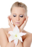 Beautiful blonde woman with lily flower Royalty Free Stock Photos