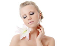 The beautiful blonde woman with lily flower Royalty Free Stock Photos