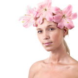 Beautiful blonde woman with lily flower isolated Stock Images
