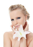 The beautiful blonde woman with lily flower Royalty Free Stock Photography